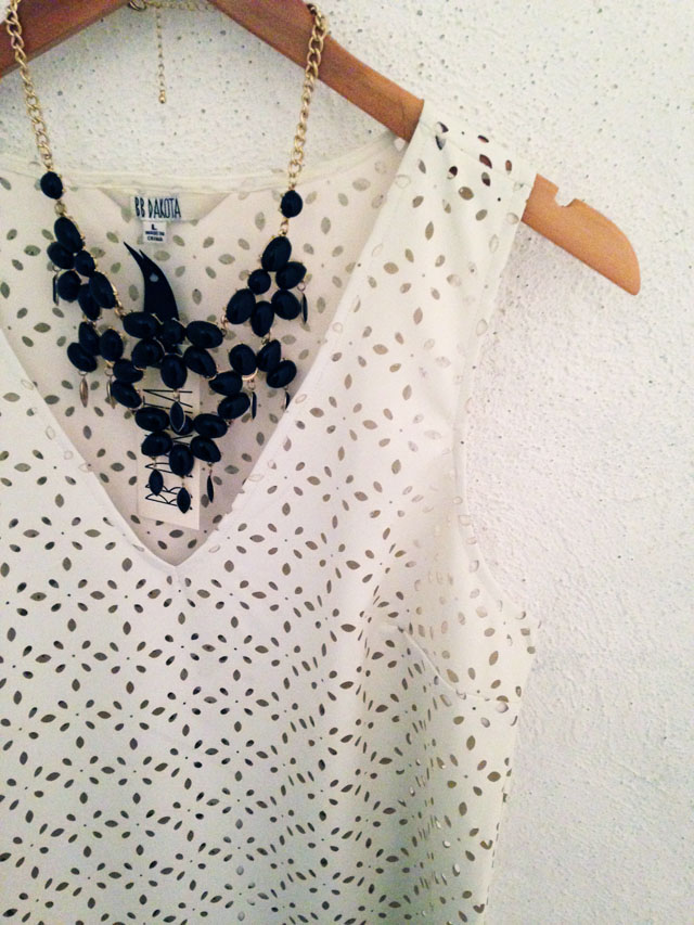 black statement necklace and white tank
