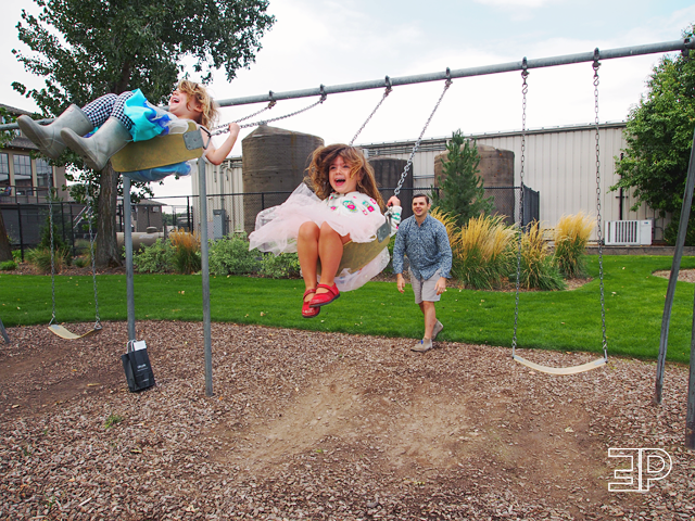 children enjoying the swing set in the back of Lecole Winery in Walla Walla, WA. - via The Emerald Palate