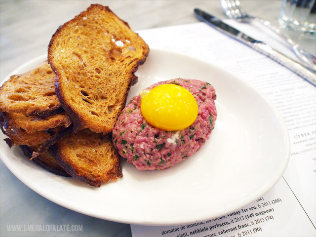 The Walrus and Carpenter in Seattle serves the best steak tartare I have ever had. It is super creamy thanks to a raw egg, salty, and crunchy because of the rye toast crisps. I highly recommend trying this if you go to this popular French restaurant in Seattle!