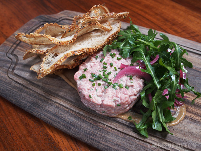 Bramling Cross in Seattle makes one of the best steak tartares in Seattle. It's creamy and crunch like the traditional French steak tartare, but is also served with a smoke eggplant puree and harissa.