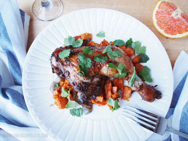 This easy chicken recipe is SO easy and flavorful. It has orange, cocoa, chipotle and cilantro served with sweet potatoes and onions. Pair it with an earthy Malbec for a great easy meal!