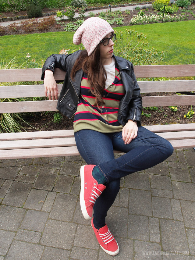 Relaxing at Butchart Gardens in Victoria, BC in a vintage striped mens henley, slouchy beanie made in the PNW, red sneakers, and a faux leather jacket. A great spring fashion inspiration example!