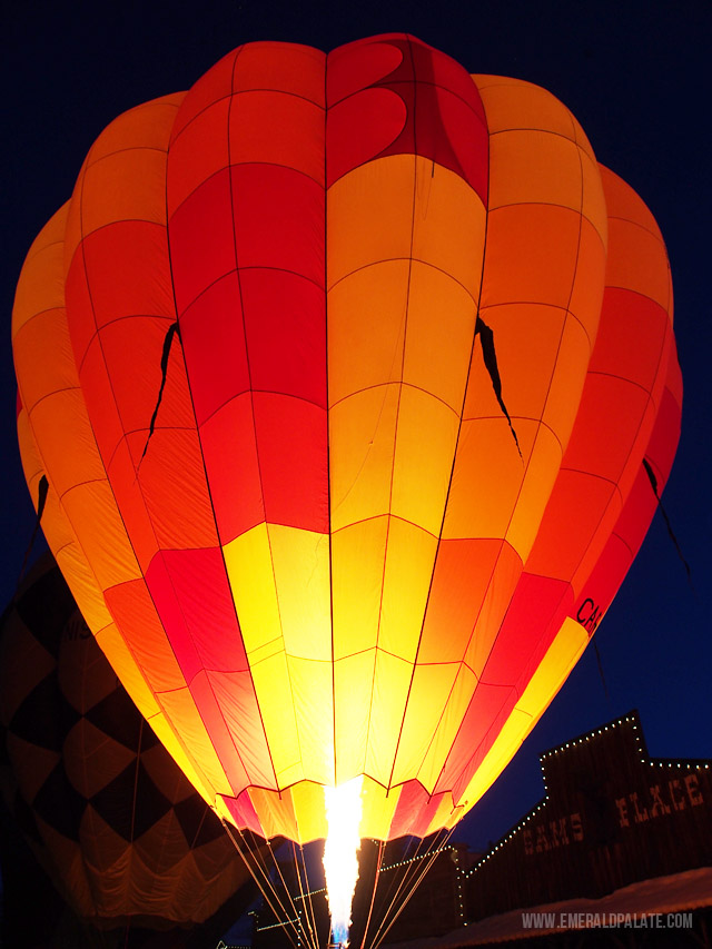 One of the majestic hot air balloons glowing in the night sky at the Winthrop Hot Air Balloon Festival in central Washington.