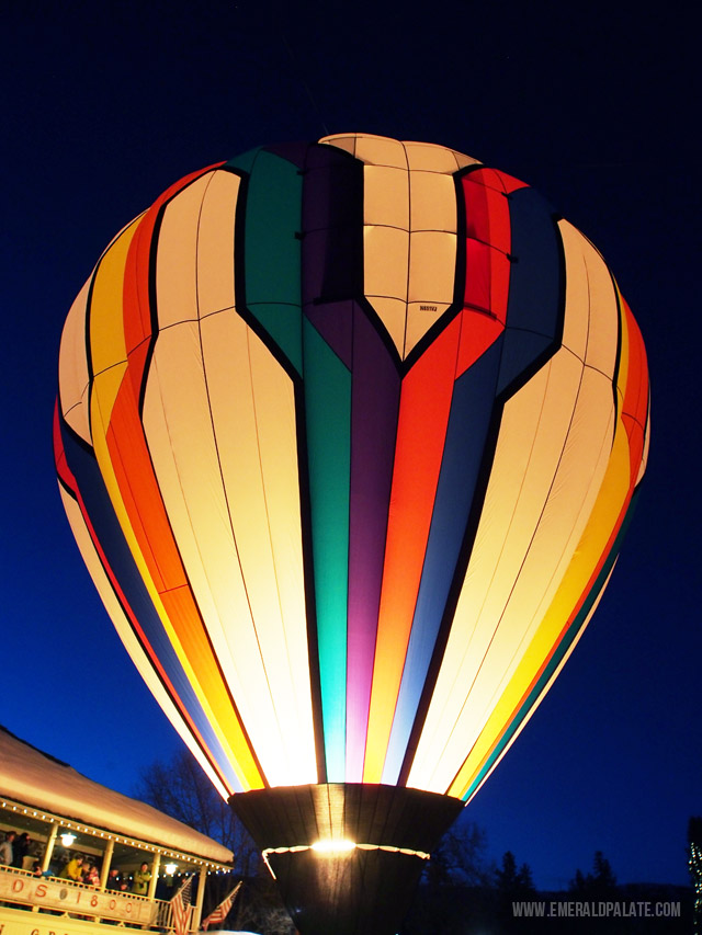 A beautiful and colorful hot air balloon glowing in downtown Winthrop, WA for the central Washington's annual hot air balloon festival.