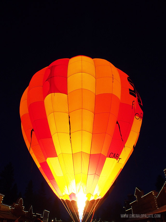 An orange glowing hot air balloon at the Winthrop Hot Air Balloon Festival.