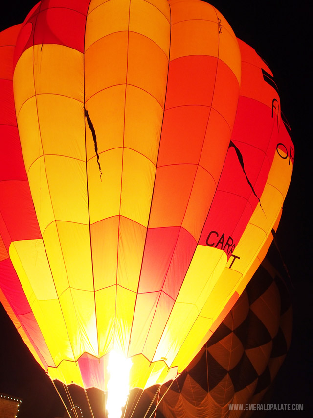 A close up of a glowing hot air balloon at the Winthrop Hot Air Balloon Festival in Winthrop, WA.
