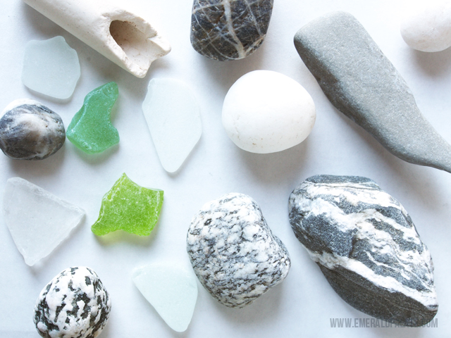 A collection of sea glass and stones found on the beach that would make the best DIY necklace.