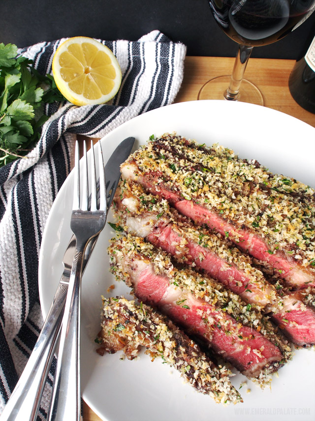 This easy steak recipe is pan seared and then crusted with a jam-mustard rub and panko, rosemary, garlic, and lemon zest crust. Super easy and perfect with a big bold red wine!