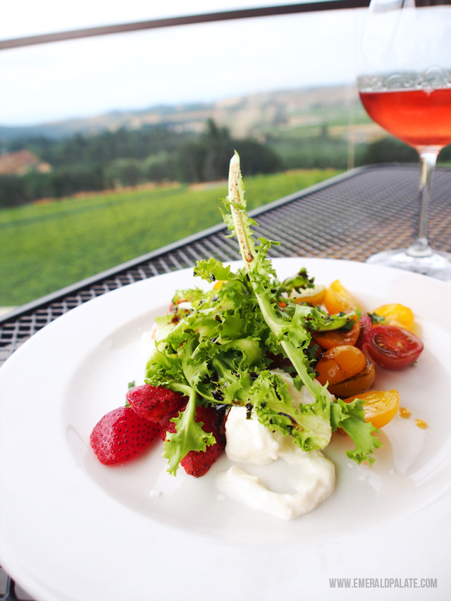 Willamette Valley Vineyards in Oregon has views of vineyards for days and really yummy food, like this burrata, pickled strawberry, and tomato salad.
