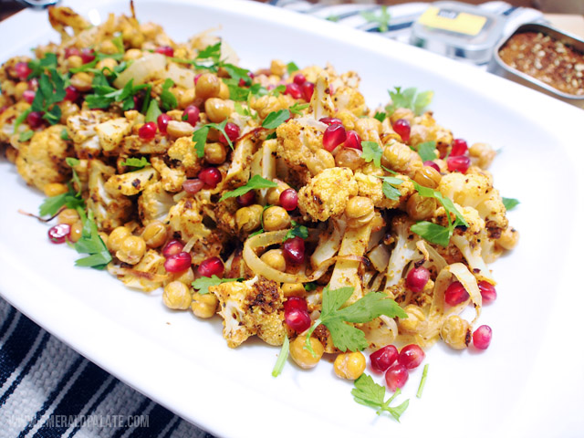 Looking for a super easy Mediterranean recipe? Try this roast cauliflower with chickpeas, tahini, cacao-masala, and pomegranates!