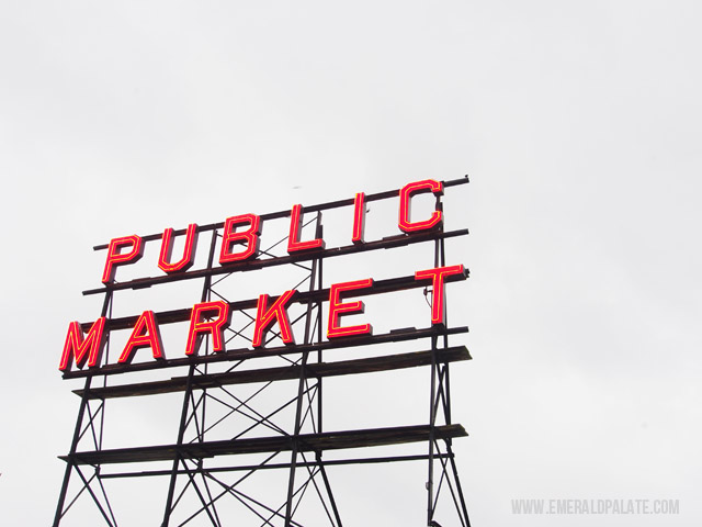 View of the Pike Place Market sign in the rain in downtown Seattle.
